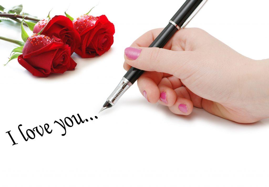 Frauenhand schreib I Love You mit Füller